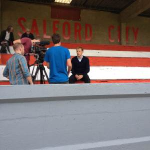 Phil Neville fulfilling media duties ahead of Salford's impressive First Qualifying Round win.
