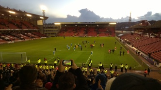 The players celebrate the result in front of the North Stand.