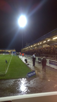 A sold-out terrace shelters from the rain.