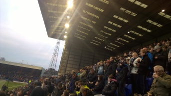 A busy Kop cheers on Tranmere for their biggest crowd of the season.