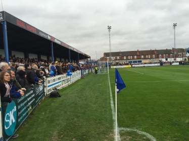 A packed terrace show their appreciation for the home side